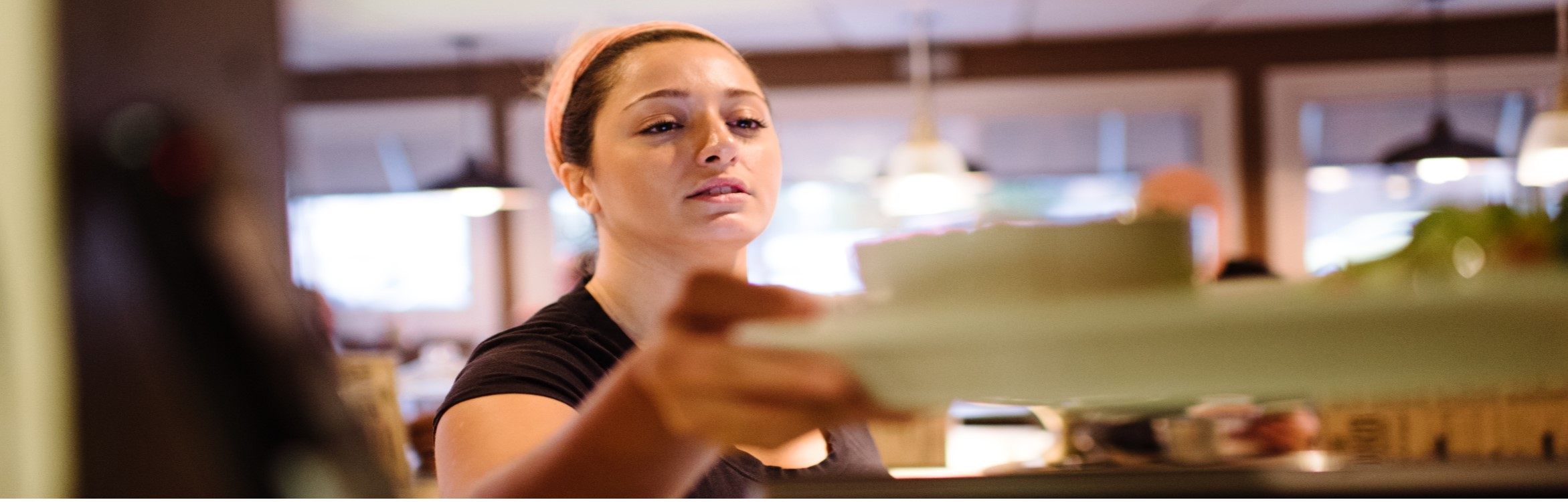 Waitress picking up a meal